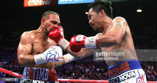 TOPSHOT Filipino boxer Manny Pacquiao slams a right to the face of US boxer Keith Thurman during their WBA super world welterweight title fight at...