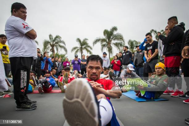 Filipino boxer Manny Pacquiao trains in the morning with fans and friends at Pan Pacific Park in Los Angeles on June 20, 2019. - Veteran trainer...