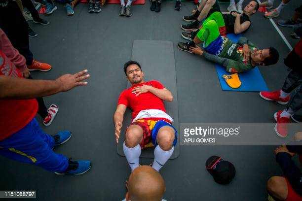 Filipino boxer Manny Pacquiao trains in the morning with fans and friends at Pan Pacific Park in Los Angeles on June 20 2019 Veteran trainer Freddie...