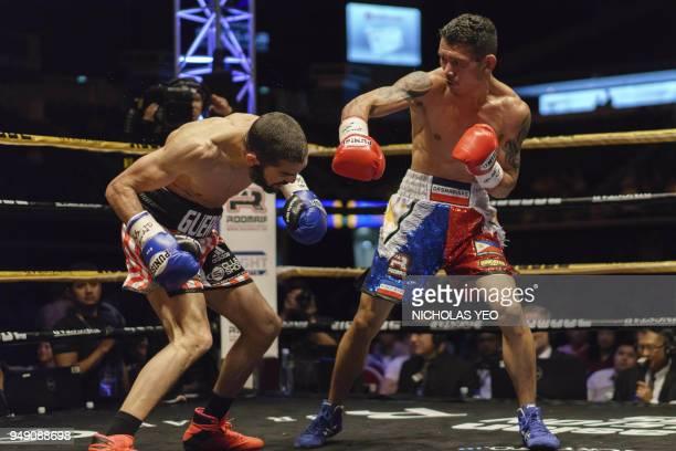 Filipino boxer Michael Dasmarinas fights French opponent Karim Guerfi during the International Boxing Organisation Batamweight world title in...