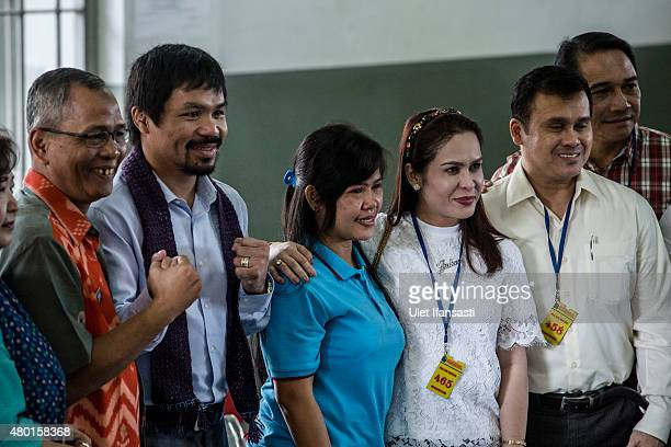 Filipino boxing icon Manny Pacquiao and his wife Jinkee meet convicted drug trafficker Mary Jane Veloso of the Philippines during a visit at...