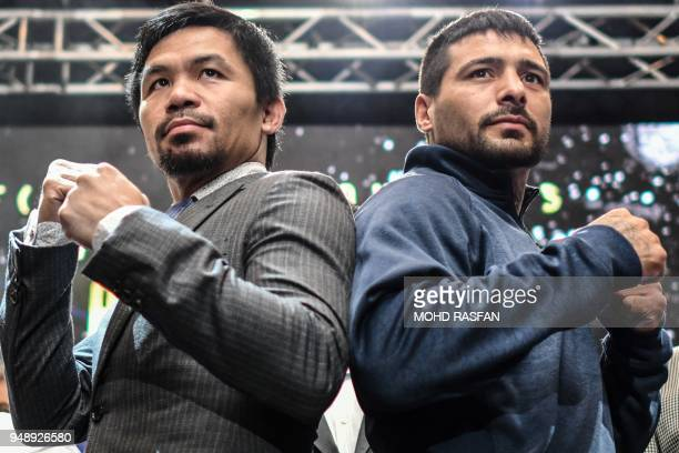 TOPSHOT Filipino boxing idol Manny Pacquiao poses for photographs with Argentina's Lucas Matthysse after a press conference in Kuala Lumpur on April...