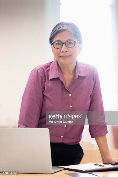 Filipino businesswoman using laptop at table