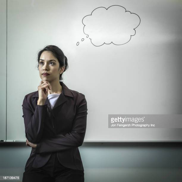 Filipino businesswoman with thought bubble in office