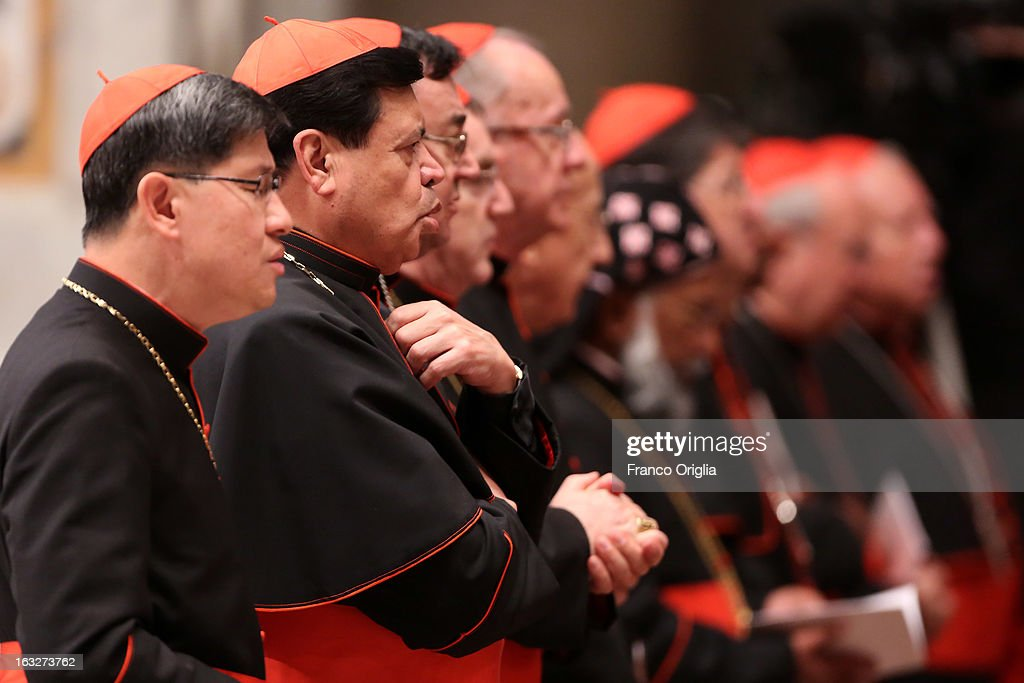 Filipino cardinal Luis Antonio Tagle (L) and archbishop of Mexico City cardinal Norberto Rivera Carrera (2nd L) attend a meeting of prayer at St. Peter's Basilica on March 6, 2013 in Vatican City, Vatican. The start-date of the conclave to elect a new Pope, following the resignation of Pope Benedict XVI, has yet to be confirmed as many cardinals have sought more time to discuss the issues currently facing the Catholic church.