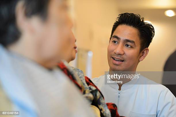 Filipino care worker John Denmark Pineda talks to an elderly resident as he works at Eisei hospital in Tokyo Japan on Monday Dec 6 2016 Strict...