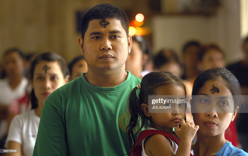 A Filipino Catholic Family Attends Mass Pictures Getty Images