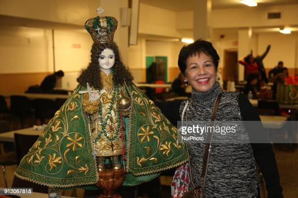 Filipino Catholic woman carrying her statue of Santo Niño during the Feast of Santo Niño de Cebú in Toronto Ontario Canada Devotion to the Santo Niño...