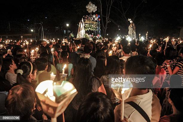 Filipino Catholics witness the meeting of the 'Risen Christ' and 'Mother Mary' during Easter Sunday rites in Santo Domingo church in Quezon city...