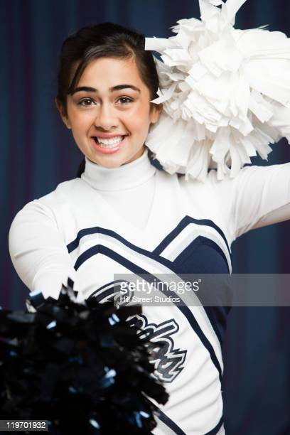 filipino cheerleader with pompoms in uniform - gardena california stock pictures, royalty-free photos & images