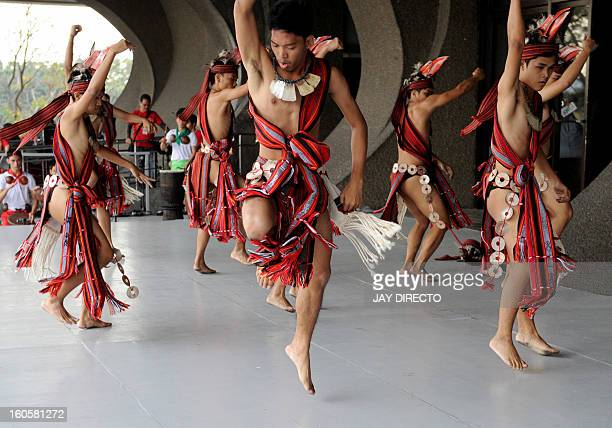 Filipino dancers perform an Ifugao tribal dance during the Pasinaya Festival in Manila on February 3 2013 The Cultural Center of the Philippines held...
