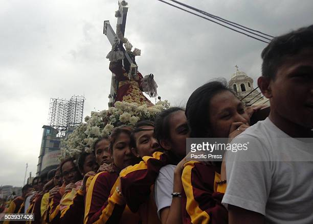 Filipino devotees carry a replica of the Black Nazarene during a procession ahead of the Black Nazarene feast day celebrations in Manila Philippines...