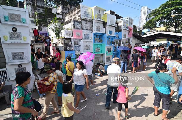 CITY PHILIPPINES Filipino families flock to a public cemetery as All Saints' Day is celebrated on November 1 2013 in Marikina City Philippines As the...