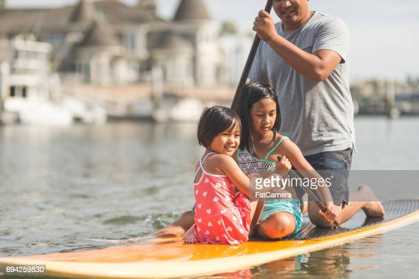 filipino family enjoying a day at the beach - philippine independence day stock pictures, royalty-free photos & images