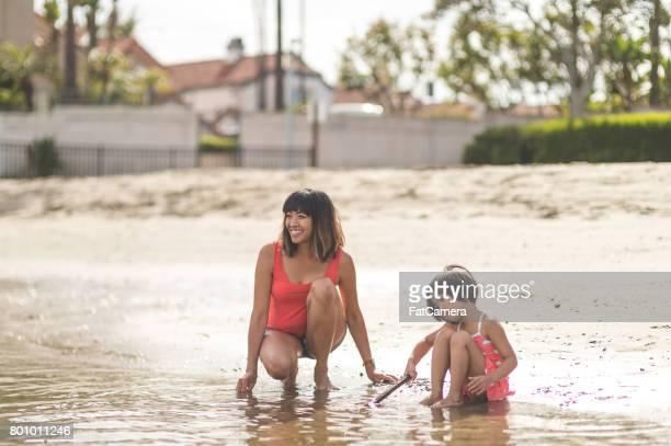 Filipino Family Enjoying a Day at the Beach