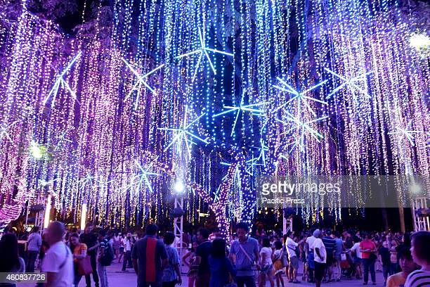 Filipino family enjoys taking their pictures during the The Festival of Lights at the Ayala Triangle Gardens in Makati City For the fifth in a row...