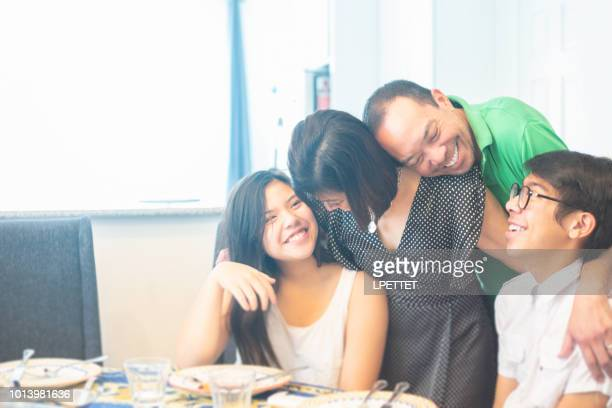 filipino family - filipino family dinner stock pictures, royalty-free photos & images