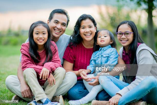 filipino family portrait outside in the summertime - philippines stock pictures, royalty-free photos & images