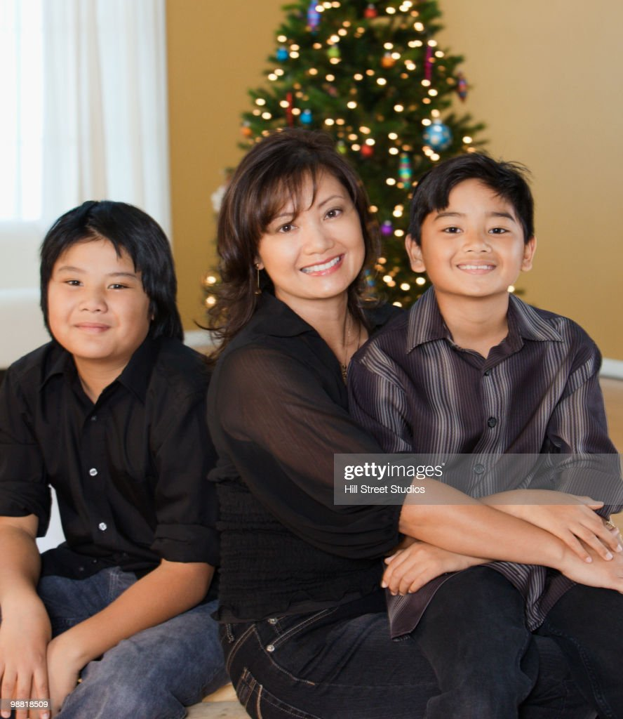 Filipino Family Smiling At Christmas Time Stock Photo