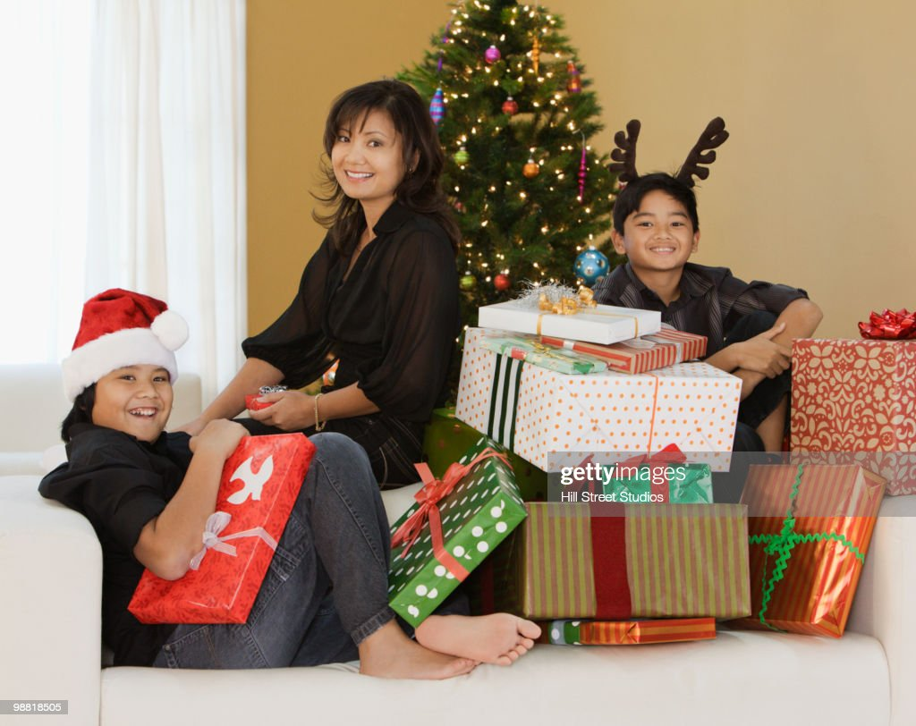 Filipino Family With Stack Of Christmas Gifts Stock Photo | Getty Images