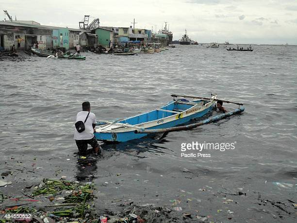 Filipino fishermen align their boats towards Manila Bay in Navotas City north of Manila Philippines Typhoon Goni has slowed down after entering the...