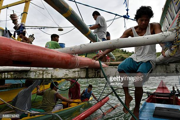 Filipino fishermen prepare and resupply for another fishing trip to the Spratlys on July 10 2016 in Mariveles Bataan Philippines Filipino fishermen...