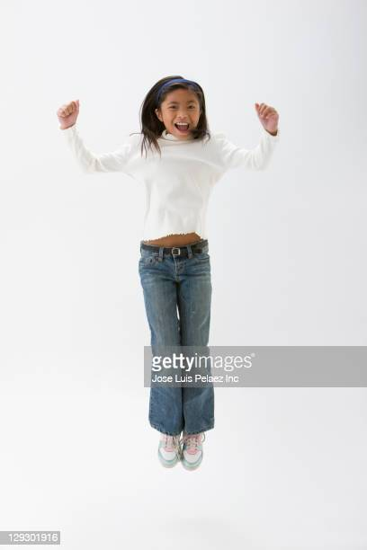 Filipino girl cheering and jumping