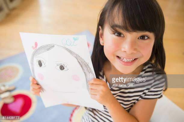 filipino girl displaying drawing in bedroom - girl strips stock pictures, royalty-free photos & images