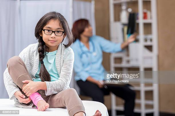 filipino girl holds injured ankle - pretty asian feet stock photos and pictures