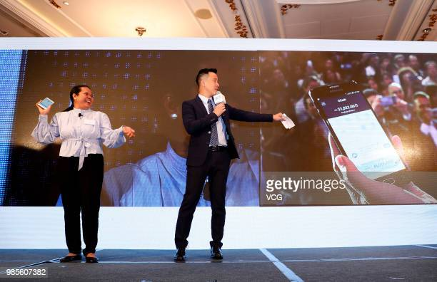 Filipino guest demonstrates the crossborder remittance service between Hong Kong and the Philippines during a news conference on June 25 2018 in Hong...