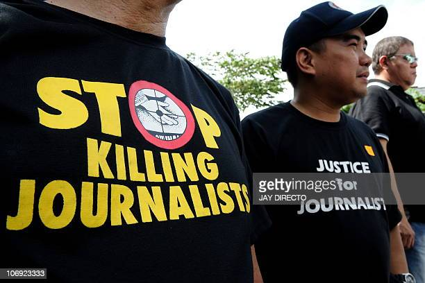 Filipino journalists rally outside a jail faclility where a special court is trying members of the powerful Ampatuan clan for the Philippines' worst...