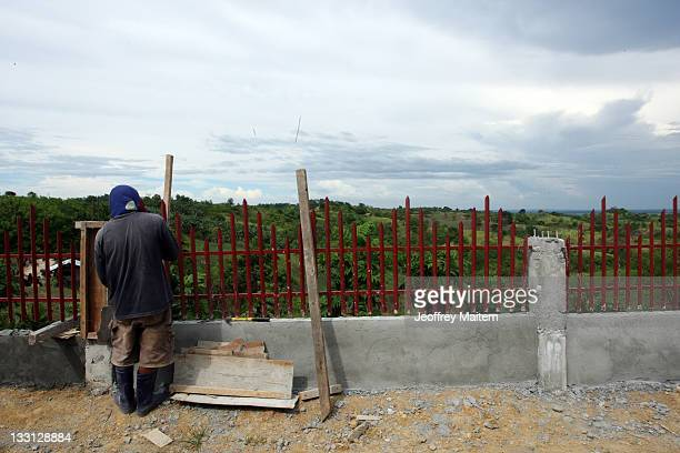 Filipino laborer works at the site where 58 people 32 of them journalists were killed by members of a powerful Muslim clan on November 23 2009 ahead...