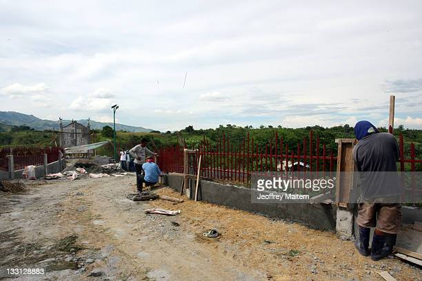 Filipino laborers work at the site where 58 people 32 of them journalists were killed by members of a powerful Muslim clan on November 23 2009 ahead...