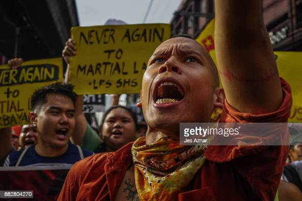 Filipino leftist protesters march against President Rodrigo Duterte on the streets on November 30 2017 in Manila Philippines After announcing his...