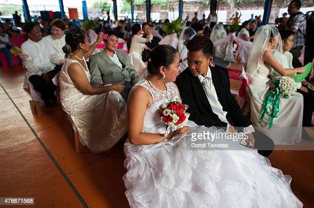 Filipino LGBT couples exchange 'Rite of Holy Union' vows during a mass 'wedding rites' on June 28 2015 in Manila Philippines A small Christian...