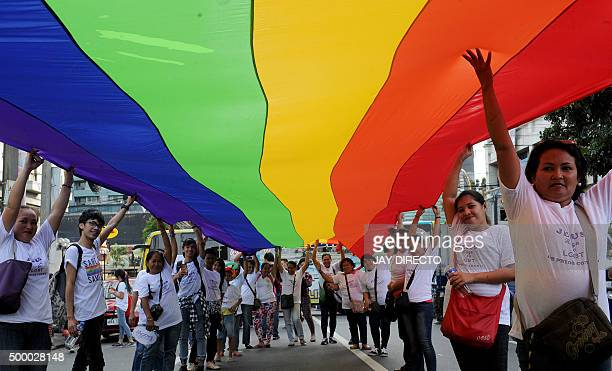 Filipino members and supporters of the LGBT community take part in an annual gay pride march calling for equal rights for lesbian gay bisexual and...