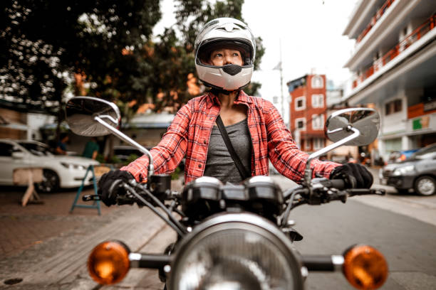 Filipino motorcyclist on motorcycle