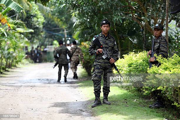 Filipino Muslim rebels of the Moro Islamic Liberation Front, the country's largest rebel group in the Philippines, are seen inside their camp on...
