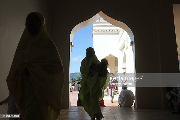 Filipino Muslims are seen after their prayers at the mosque as they celebrate Eid ulFitr on August 30 2011 in the southern city of Cotabato...