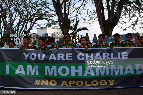 Filipino Muslims attend a protest rally on January 14 2014 in Marawi Philippines They were protesting at what they described as 'Double Standard'...