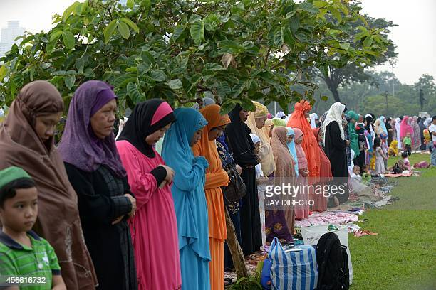 Filipino Muslims attend an early morning prayer at Luneta Park in Manila on October 4 to mark Eid alAdha or the Feast of Sacrifice Muslims around the...
