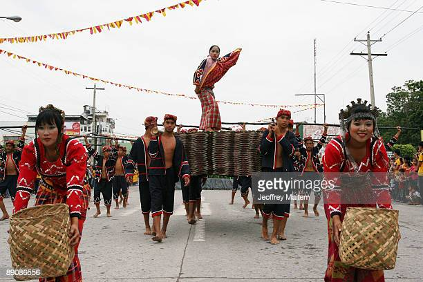 Filipino native are seen performing at the 2009 T'nalak Festival showcasing South Cotabato Province tribal cultures on July 18 2009 in the southern...