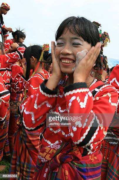 Filipino native prepares before performing at the 2009 T�nalak Festival showcasing South Cotabato Province tribal cultures on July 18 2009 in the...