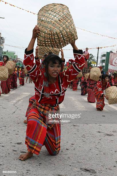 Filipino natives are seen performing at the 2009 T'nalak Festival showcasing South Cotabato Province tribal cultures on July 18 2009 in the southern...