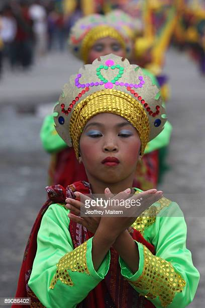 Filipino natives perform at the 2009 T�nalak Festival showcasing South Cotabato Province tribal cultures on July 18 2009 in the southern city of...