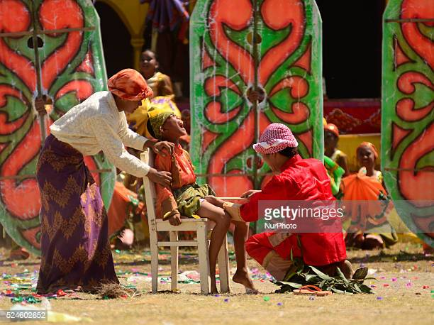 Filipino performers wearing a colorful costume demonstrate traditional circumcision process as they participates in a traditional dance competition...