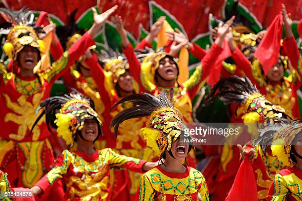 Filipino performers wearing a colorful costume participates in a traditional dance competition as part of the Kadayawan Festival in Davao City...