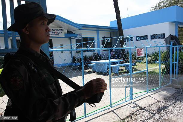 Filipino policeman stands guard at the entrance of CIDG headquarters where four detained members of the Ampatuans a powerful Muslim clan detained for...
