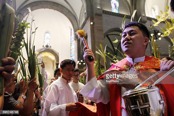 A Filipino priest blesses palm fronds in observance of Palm Sunday at Manila Cathedral in Intarmuros Manila Philippines on March 20 2016 Palm Sunday...