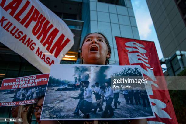 Filipino protester shouts anti-China slogans as she takes part in a protest and candlelight outside the Chinese embassy to mark the 30th anniversary...